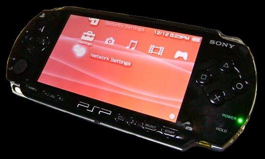 Sony PSP W/ 4GB memory stick & 3 UMDS
