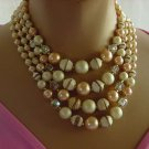 Vintage Necklace Japan cream brown tan iridescent bead Four strand oval bead necklace  No. 108