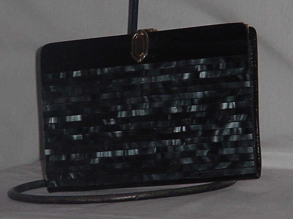 Black pearlized plastic clutch purse   No. 138