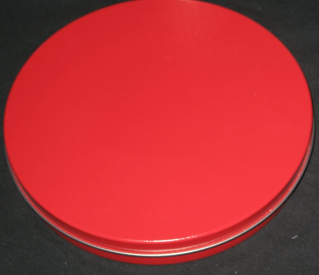 Wide thin red tin can