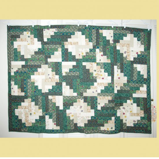 """Green Woodpile Sofa Size Quilt, 55""""x73"""""""