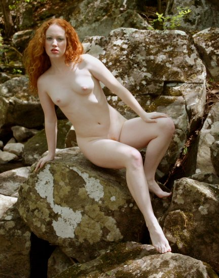 The beautiful natural Red Head #03 Posing on stream side boulders