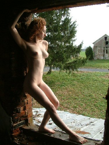Hot Redhead Stripper in the burned out farmhouse  03