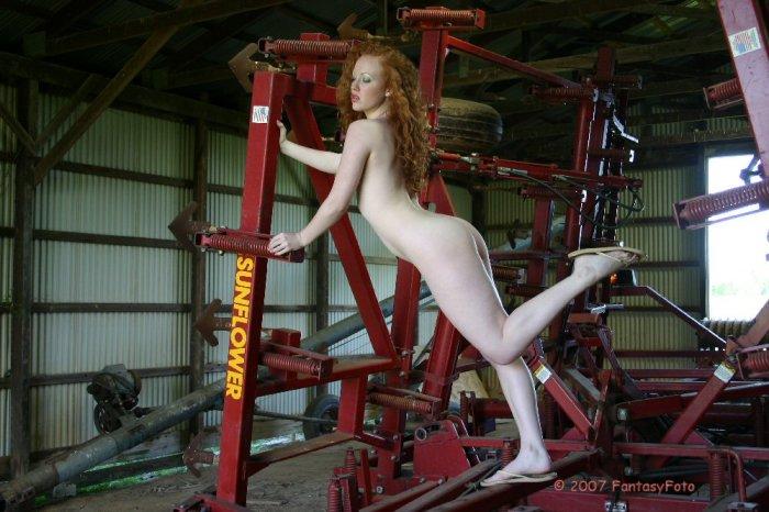 Hot naked redhead checking the farm equipment