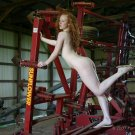 Hot naked redhead checking the farm equipment