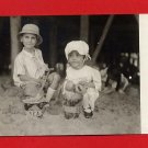 Vintage Real Photo Postcard RPPC by AZO - 2 children on beach sand RP5