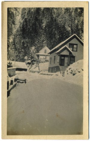 Real Photo Postcard - Homes on Hillside in Deep Snow