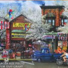 SunsOut Tom Wood Afternoon on Main Street 1000 pc Jigsaw Puzzle XL Pieces