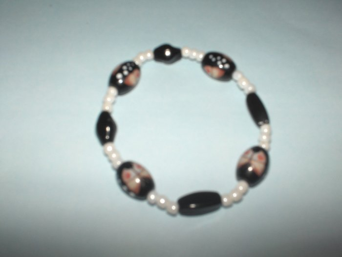 Black glass bead stretch bracelet with butterfly design
