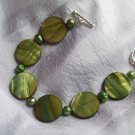 Green  lentil shell bead bracelet with freshwater pearls, toggle closure