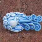 Wind polymer clay focal bead