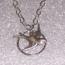 Sparrow Bird Necklace over a Sterling Hammered Circle and Sterling silver Chain