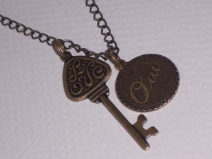 OUI Love Key Pendant on antiqued brass chain necklace
