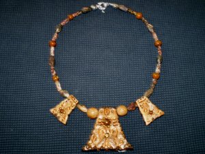 Unique Handcrafted Pendants surrounded by Leopard Skin and Caramel Jasper