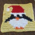 Christmas Crochet Penguin dishcloth yellow background