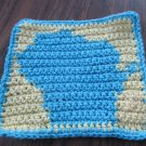 Crochet Wisconsin dish cloth,yellow background