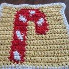 Christmas Candy cane dishcloth yellow background