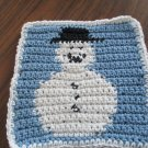 Christmas Crochet snowman dish cloth blue background