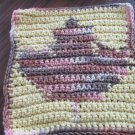 Crochet leaf dish cloth yellow background