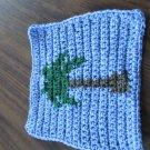 Crochet palm tree dish cloth blue background