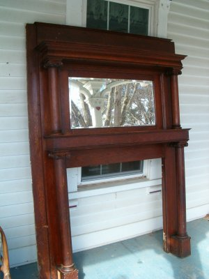 This is a beautiful quartersawn oak mantle in original finish. This mantle is in very good condition.  Has beveled mirror which is also in very good c