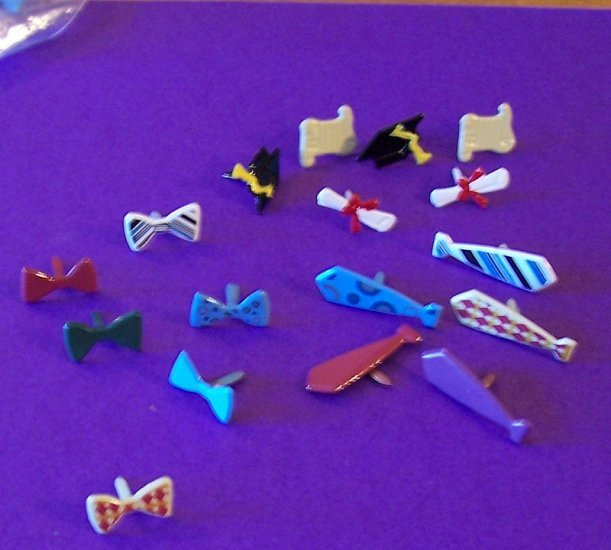 Lot of 17 brads in 3 designs and variety of colors for scrapbooks