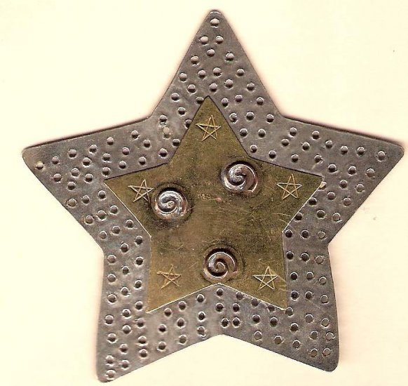 Large pewter and brass star for embellishing almost anything