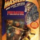 Predator figure - Kenner, dated 1994, diecast metal, MIP die cast movie figure