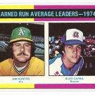1975 Topps baseball card #311 (B) ERA Leaders Jim Catfish Hunter & Buzz Capra NM/M