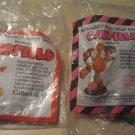2 Garfield skater figures 1988 McDonalds Happy Meal toy, MIP never opened skateboard roller skates
