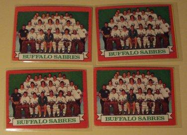 Four (4) 1973/74 Topps Buffalo Sabres Team Hockey card #94