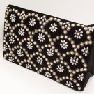 Black purse with fish scale pattern