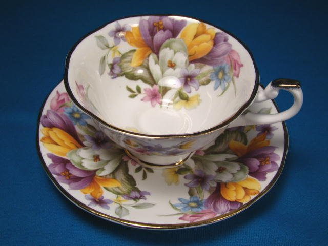 Fine bone china England footed tea coffee cup saucer purple yellow blue flowers Crown mark porcelain