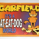 Garfield It's a Cat Eat Dog World Book Paperback Soft Cover Odie PAWS Jim Davis