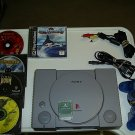 Sony PlayStation Complete with 4 Games (FREE SHIPPING)