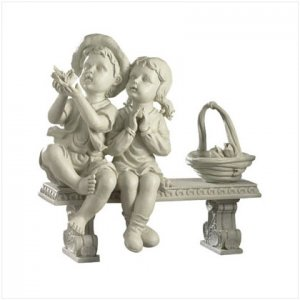 Adorable Kids Sitting on a Bench Statue