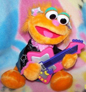 Rock & Roll Zoe, Sings, Plays Guitar, toys,