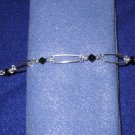Swarovski Crystal and Black Bicone Handmade Beaded Bracelet with Silver Round and Spacer Beads