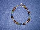 Multi Colored Handmade Beaded Bracelet with Blue, Green, Amber, Purple, Red and Silver Beads