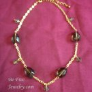 Gold and olive green beaded necklace