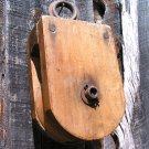 Old wooden rope pulley with wood wheel ec
