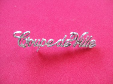 Cadillac Coupe de Ville emblem ornament