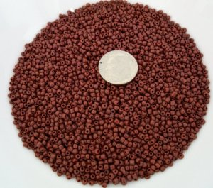 Size 11 Matsuno seed beads opaque red brown15 grams