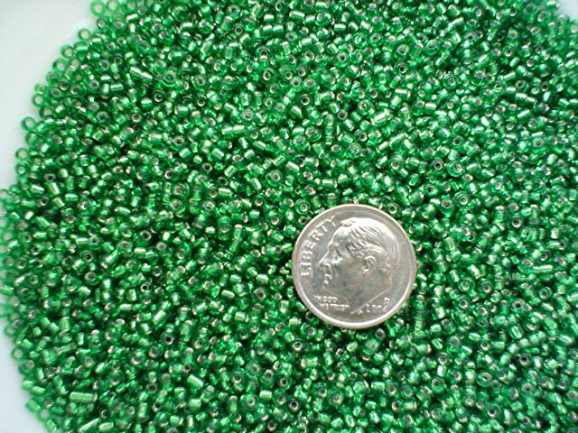 Size 11 Celestial silver lined beads emerald15 grams
