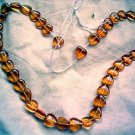 Pressed glass beads amber puffed heart 10 mm 16 inch strand