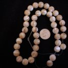 Mother of Pearl Round beads beige 10 mm 16 inch strand