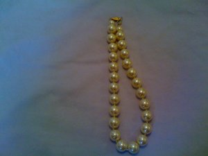 Faux pearl necklace.