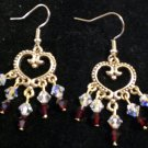 Chandelier earrings made with genuine Swarovski crystals in siam satin and crytal clear AB