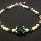 Swarovski crystal pearls in cream and Swarovski crystals in emerald with silver components