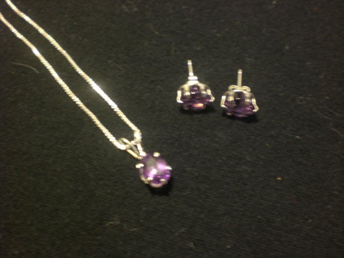 Genuine Amethyst set in sterling silver settings and pendant is on a sterling silver chain